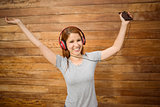Dancing woman listening to music with headphones