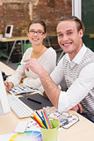 Smiling photo editors at work in office