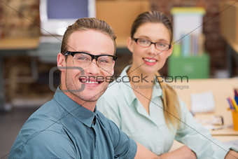 Smiling business colleagues in office
