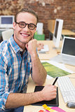 Smiling male photo editor in office