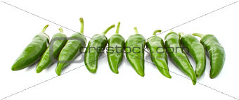 Green hot pepper in a row