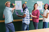 Creative business people at work by blackboard