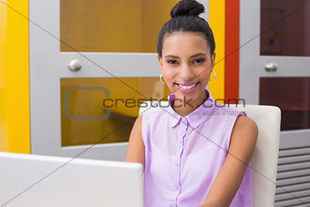Portrait of businesswoman using laptop