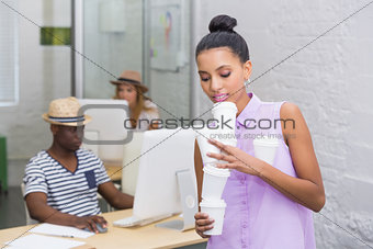 Casual woman holding disposable cups in office