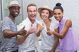 Creative business people gesturing thumbs up