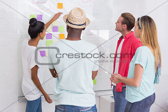 Creative team looking at sticky notes