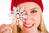 Festive blonde holding snowflake decoration