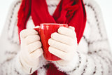 Woman in warm clothing holding mug
