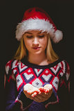 Festive blonde holding her hands out