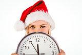 Festive blonde holding a clock