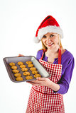 Festive blonde showing hot cookies
