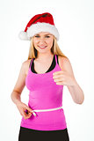Fit festive young blonde measuring her waist
