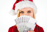 Festive blonde in red dress showing her cash