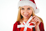 Festive blonde in red dress opening a gift