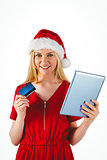 Festive blonde shopping online with tablet