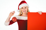 Festive cute blonde holding poster and bauble