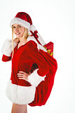 Festive blonde carrying sack of presents