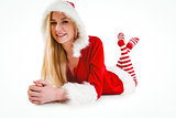Festive blonde using tablet pc
