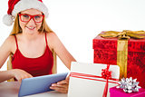 Festive blonde shopping online with tablet pc