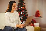 Pretty brunette shopping online at christmas