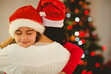 Mother and daughter hugging at christmas