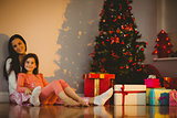 Mother and daughter waiting for santa claus
