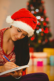 Festive brunette writing her list