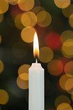 White candle burning brightly