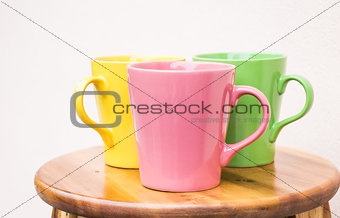 Beautiful ceramic cups on wooden table