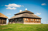 Beautiful restored old style russian farmhouse with thatch roof