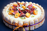 Cheesecake decorated with fig and kumquat