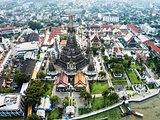 Wat Arun Temple and Chao Phraya Riverside in Bangkok Thailand.