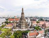 Wat Arun Temple and Chao Phraya Riverside in Bangkok Thailand.