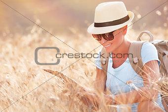 Tourist girl exploring map