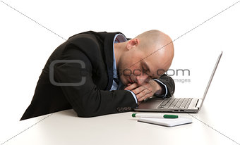 Tired businessman sleeping at work place