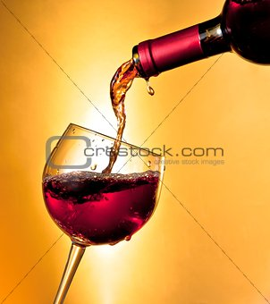 pouring red wine in the glass tilted
