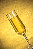 tilted flute of golden champagne