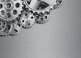 Steel gear wheels on metal background