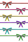 collection of colorful ribbons and bows rep on an isolated white