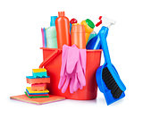 detergent bottles, brushes, gloves and sponges in bucket isolate