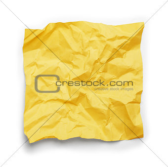 crumpled yellow sticker on an isolated white background