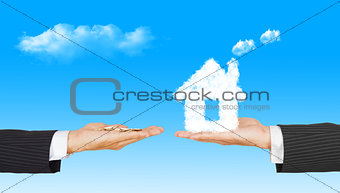 business Hands with money and house from clouds on blue sky back