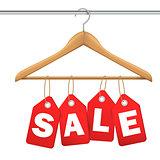 Red Tag With Sale Sign Hanging on Wooden Hanger - With Clipping Path