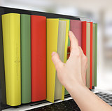 Laptop and colorful book. education