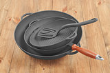 cast iron frying pan on a wooden background