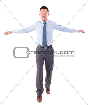 Asian business man walking balance