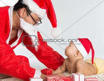 Asian santa claus with baby