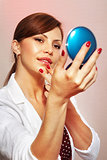 smartens up with compact mirror
