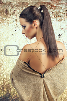 Beautiful woman standing back