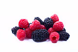 Blackberries and raspberries on a white background